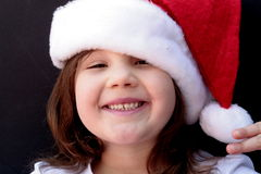 Happy little girl in Santa hat Stock Image