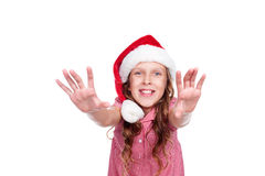 Happy little girl in santa hat Royalty Free Stock Photo