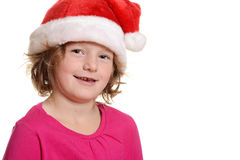 Happy little girl with santa hat Stock Image