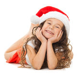 Happy little girl in Santa hat royalty free stock image