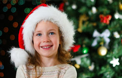 Happy little girl in santa's hat Royalty Free Stock Photos