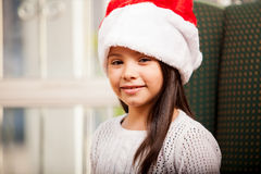 Happy little girl in Santa's hat Stock Photography