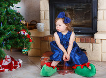 Happy little girl in santa shoes have a christmas. Royalty Free Stock Photos