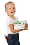 Happy little girl with school books stock images