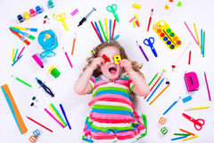 Happy little girl with school supplies Stock Photography