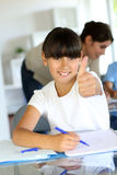 Happy little girl at school with thumb up Stock Images