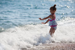 Happy little girl and sea Royalty Free Stock Photo