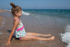 Happy little girl and sea Royalty Free Stock Photos