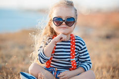Happy little girl at the seaside in the summer. Royalty Free Stock Images