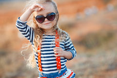 Happy little girl at the seaside in the summer. Stock Photography