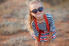 Happy little girl at the seaside in the summer. Stock Image