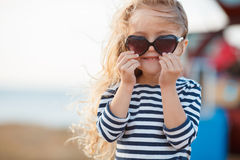 Happy little girl at the seaside in the summer. Royalty Free Stock Photography