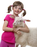 Happy little girl with sheep Royalty Free Stock Images