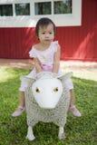 Happy little girl in the garden Stock Images