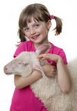 Happy little girl with a sheep Royalty Free Stock Images