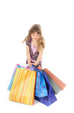 Happy little girl shopping Stock Photos