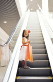 Happy little girl with shopping bag. In the mall Royalty Free Stock Image