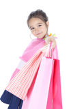 Happy little girl with shopping bags over white Stock Images