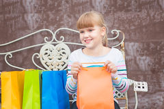 Happy little  girl  after shopping Royalty Free Stock Photo