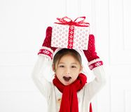 Little girl showing christmas gift. Happy little girl showing christmas gift stock photos