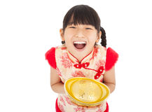 Happy little girl showing  gold Stock Photo