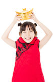 Happy little girl showing  gold for chinese new year Stock Photography