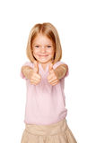 Happy little girl showing a thumbs up sign Royalty Free Stock Photos