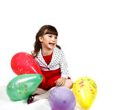 Happy girl with balloons Stock Photos