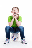 Happy little girl sitting on the ball. Stock Image