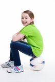 Happy little girl sitting on the ball. Stock Photo