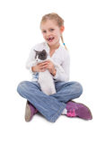 Happy little girl sitting with cat in her arms. On white background Stock Images