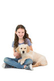 Happy little girl sitting with dog on her legs. On white background Stock Photography