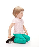 Happy little girl sitting on the floor Stock Photography