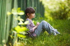 Happy little girl sitting Royalty Free Stock Photos