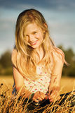 Smiling girl in meadow Stock Image