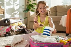 Little girl packing suitcase Royalty Free Stock Photo