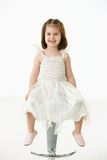 Happy Little Girl Sitting On Chair Stock Images