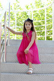 Happy Little girl sitting on the stairs Stock Photography
