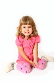 Happy little girl sitting on white background Stock Photos