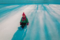 Happy cute ittle girl skating in winter royalty free stock photography
