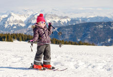 Happy little girl skiing downhill Royalty Free Stock Photography