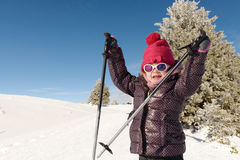 Happy little girl skiing downhill Stock Photography