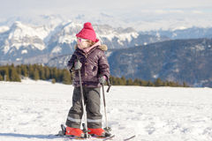 Happy little girl skiing downhill Royalty Free Stock Photos