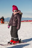 Happy little girl skiing downhill Stock Image