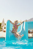 Happy little girl on slide Royalty Free Stock Image