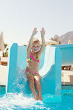 Happy little girl on slide Stock Photography