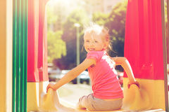 Happy little girl on slide at children playground Royalty Free Stock Photography