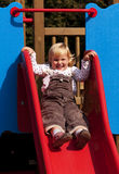 Happy little girl on slide Stock Photography