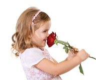 Happy little girl smelling a rose Stock Images