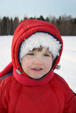 Happy little girl smiles near forest at winter Stock Photography